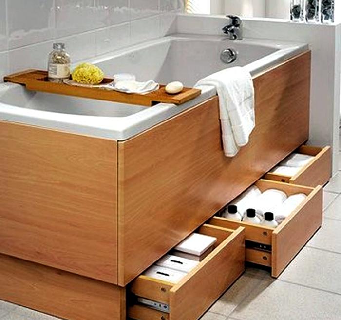 Выдвижные шкафчики под ванной.