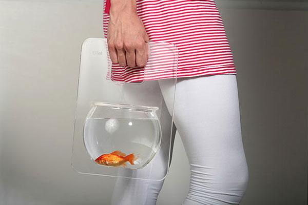 Аквариумное ассорти: столик, ваза, подлокотники и другие рыбьи домики