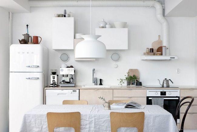 Хлопковая скатерть отлично подойдет для стола кухни скандинавского стиля