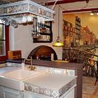 "Кухня: имитация печки и дровницы, ""бочка"" на стене, перигорский пол"