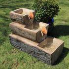 Оригинальные фонтаны из дерева своими руками