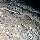 Любопытные факты о Плутоне и невероятные фотографии каменно-ледяной планеты