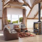 Дом с открытыми балками и свободной планировкой