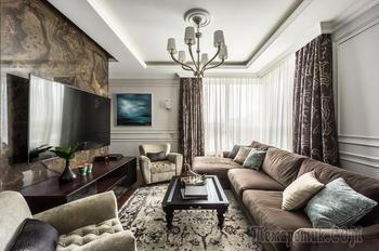 Интерьер с графичной гостиной и просторным холлом