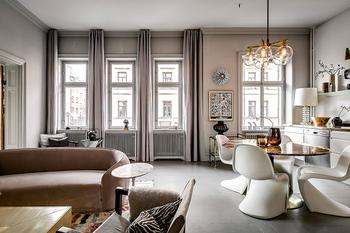 Необычная мебель и золотые детали в интерьере скандинавской квартиры (87 кв. м)