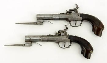 Пара капсюльных пистолетов boxlock со складным клинком и рукояткой в виде головы собаки