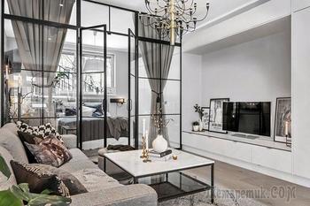 Открытое пространство и спальня за стеклом: скандинавская квартира в сером