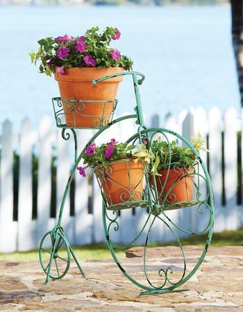 Кованые подставки для цветов: достойная опора прекрасному