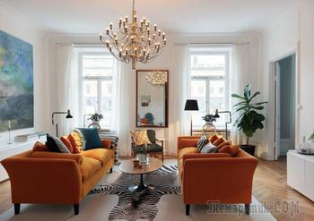 Оранжевый диван и настенная живопись: прекрасная скандинавская квартира
